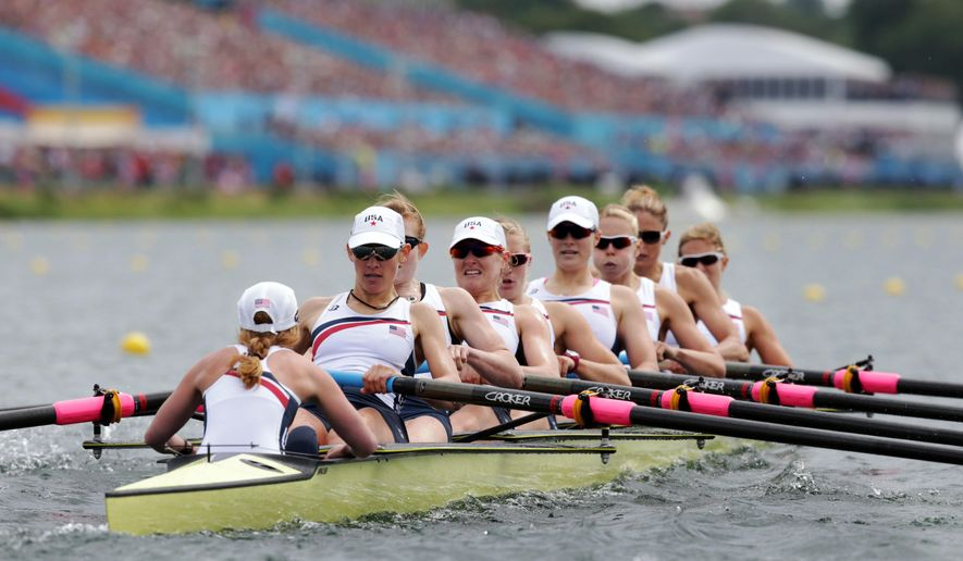 FILE - In this Aug. 2, 2012, file photo, U.S. rowers Mary Whipple, Caryn Davies, Caroline Lind, Eleanor Logan, Meghan Musnicki, Taylor Ritzel, Esther Lofgren, Zsuzsanna Francia and Erin Cafaro row on their way to winning the gold medal for the women's rowing eight in Eton Dorney, near Windsor, England, at the Summer Olympics. The Americans have won 10 consecutive world and Olympic titles in the event, a winning streak that is unmatched in most sports but little known outside the rowing world. The U.S. has dominated the event since 2006 even though coach Tom Terhaar has consistently changed the lineup, moving rowers around the boat or replacing them with others. (AP Photo/Armando Franca, Pool, File)