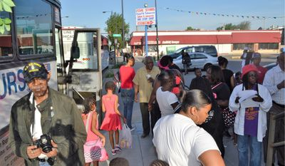 "Rep. Danny K. Davis, Illinois Democrat, gathered June 11 with more than 60 children and their families to take them by bus to see their incarcerated fathers in honor of Father's Day. Mr. Davis is a longtime champion of legislation to promote strong families and ""second chance"" programs to to reduce recidivism. (Courtesy of Rep. Danny K. Davis' legislative office)"