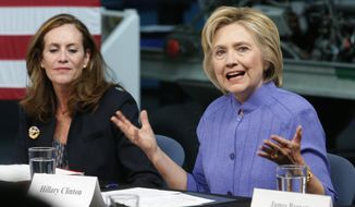 Democratic Presidential candidate Hillary Clinton, accompanied by Virginia first lady Dorothy McAuliffe, gestures as she speaks on national security, Wednesday, June 15, 2016, in Hampton, Va. (AP Photo/Steve Helber)