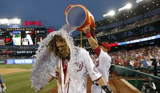 Jayson Werth gets doused by Wilson Ramos after his the game-winning RBI single. The Nationals won 5-4, in 12 innings. (AP Photo/Alex Brandon)
