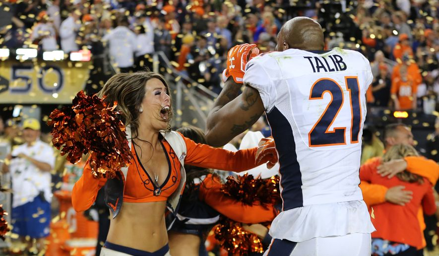 Denver Broncos' Aqib Talib #21 celebrates with a cheerleader after the NFL Super Bowl 50 football game Sunday, Feb. 7, 2016, in Santa Clara, Calif.  (AP Photo/Gregory Payan)