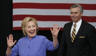Democratic Presidential candidate Hillary Clinton waves as she arrives for a speech on national security with retired Adm, James Barnett, Wednesday, June 15, 2016, in Hampton, Va. (AP Photo/Steve Helber)