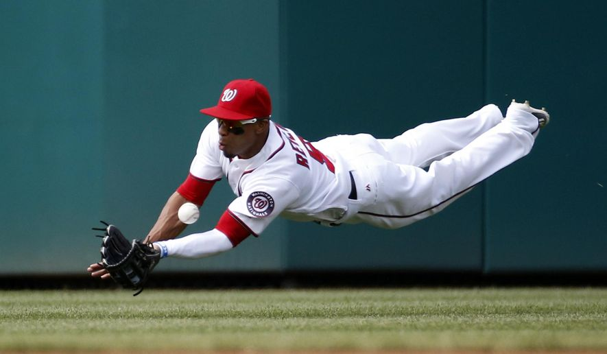 Washington Nationals center fielder Ben Revere dives but can't catch a ball hit for a double by Chicago Cubs' Jason Heyward during the first inning of a baseball game at Nationals Park, Wednesday, June 15, 2016, in Washington. (AP Photo/Alex Brandon)