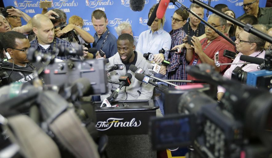 Golden State Warriors' Draymond Green answers questions before practice for Game 6 of the NBA basketball Finals, Wednesday, June 15, 2016, in Cleveland. The Cleveland Cavaliers will play the Warriors Thursday night in Cleveland. (AP Photo/Tony Dejak)