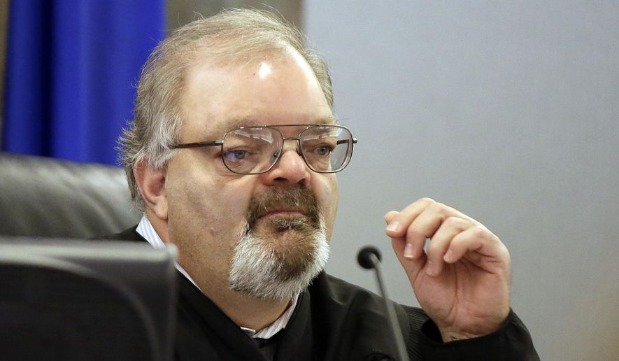 FILE - In this Feb. 23, 2015 file photo, Judge Conrad Hafen presides over a hearing in Las Vegas. A Nevada state judicial oversight panel is being asked to investigate complaints about Hafen, who ordered a public defender handcuffed in court when she wouldn't quit arguing to keep a client out of jail. (AP Photo/Isaac Brekken, File)