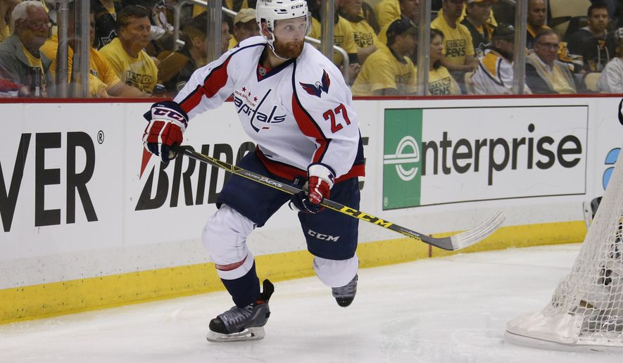 "In this May 2, 2016 file photo, Washington Capitals' Karl Alzner (27) skates during the first period of Game 3 in an NHL hockey Stanley Cup Eastern Conference semifinals against the Washington Capitals in Pittsburgh. Alzner had sports hernia surgery, Wednesday, June 15, 2016, and the team says it expects him to be ""completely healthy"" before the start of next season. (AP Photo/Gene J. Puskar)"
