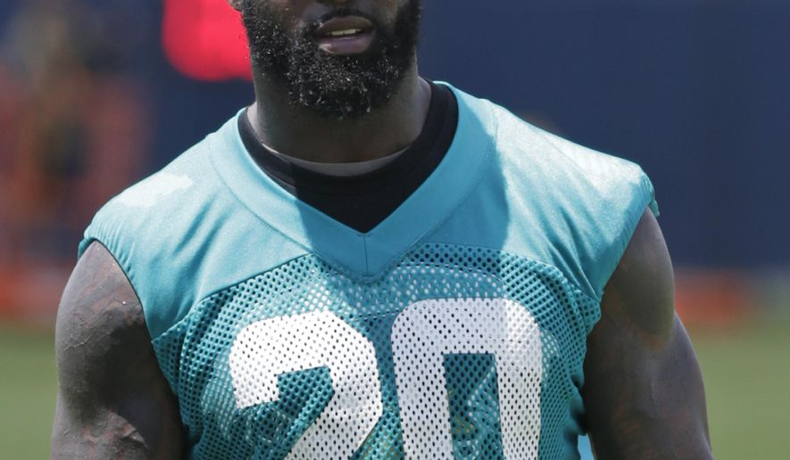 Miami Dolphins safety Reshad Jones walks off the field after the NFL football teams minicamp, Wednesday, June 15, 2016, at the Dolphins training facility in Davie, Fla. Jones joined minicamp after missing the first day of the mandatory sessions in a contract dispute. (AP Photo/Wilfredo Lee)