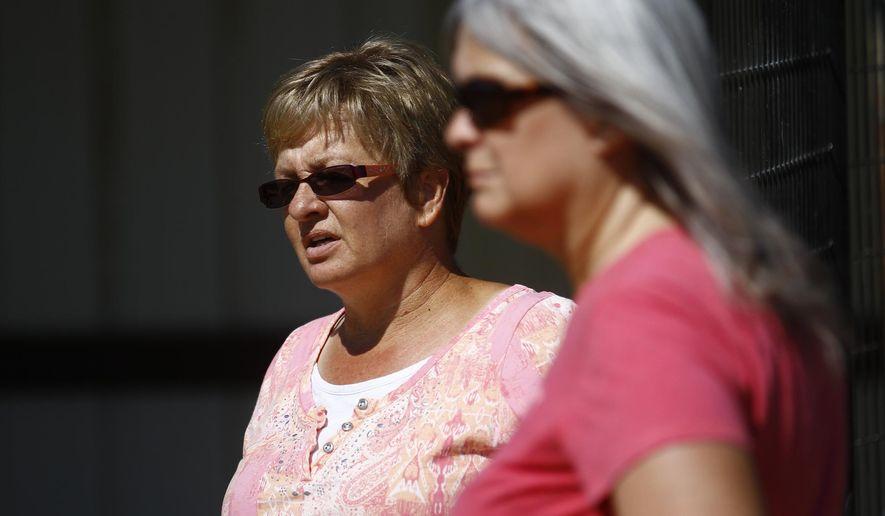 In this Thursday, June 9, 2016 photo, Carol Sanchez, left, and Kim Anderson talk at Sanchez's home in Farmington, N.M. (Jon Austria/The Daily Times via AP) MANDATORY CREDIT