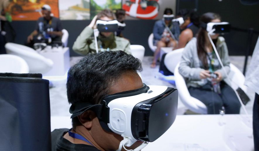 Gamers experience the Samsung Galaxy VR at the Electronic Entertainment Expo in Los Angeles on Wednesday, June 15, 2016. (AP Photo/Nick Ut)