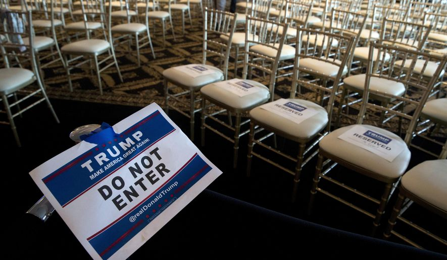 In this June 7, 2016, file photo, a sign separates members of the media from invited guests at Republican presidential candidate Donald Trump's news conference at the Trump National Golf Club Westchester, in Briarcliff Manor, N.Y. (Photo/Mary Altaffer, File)