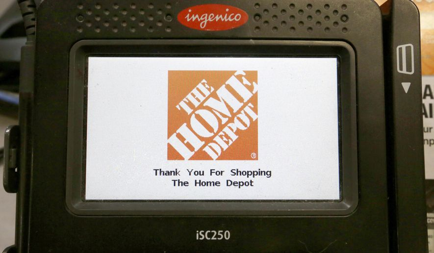 "In this Wednesday, May 18, 2016, photo, the Home Depot logo appears on a credit card reader at a Home Depot store in Bellingham, Mass. The Home Depot Inc. says in a new federal lawsuit that Visa and MasterCard are using security measures prone to fraud, putting it and other retailers at risk of hacking attacks by cyber thieves. Atlanta-based Home Depot says new payment cards with so-called ""chip"" technology, rolled out in the U.S. in recent years, remain less secure than cards used in Europe and elsewhere in the world. (AP Photo/Steven Senne)"