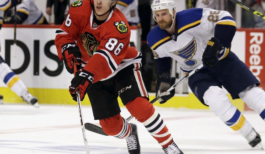 FILE - In this April 19, 2016, file photo, Chicago Blackhawks left wing Teuvo Teravainen (86) skates with the puck against St. Louis Blues center Kyle Brodziak (28) during the first period in Game 4 of an NHL hockey first-round Stanley Cup playoff series in Chicago. The Carolina Hurricanes have acquired forwards Teuvo Teravainen and Bryan Bickell from the Blackhawks in exchange for two draft picks. (AP Photo/Nam Y. Huh, File)