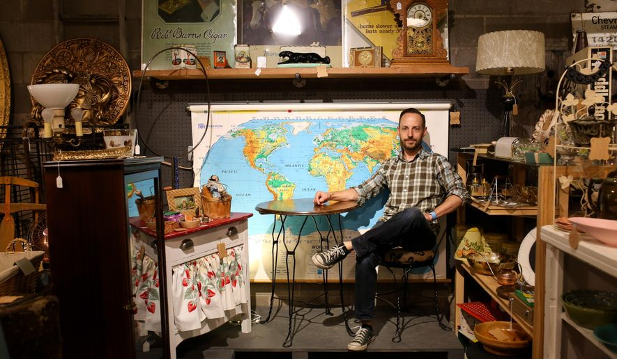 ADVANCE FOR THE WEEKEND OF JUNE 18-19 AND THEREAFTER. - In a June 1, 2016 photo, Reed Merschat poses for a portrait inside his antique mall, Survivor AC Dealers, in Casper, Wyoming. Merschat started this and other businesses in Casper to buffer himself and his family from the oil downturns.   (Jenna VonHofe/The Casper Star-Tribune via AP) MANDATORY CREDIT
