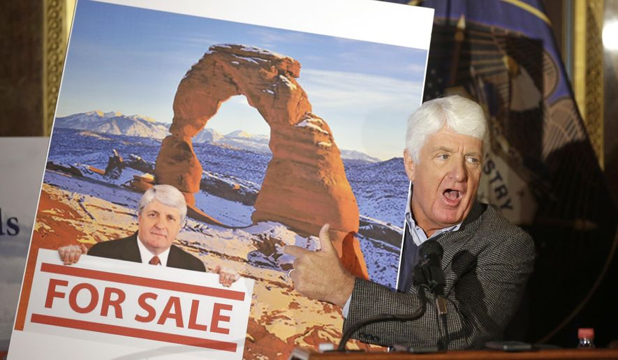 FILE - This Jan. 20, 2016, file photo, Rep. Rob Bishop, R-Utah, holds an image he says is misleading and was created by critics of his public lands proposal while speaking during a news conference at the Utah State Capitol, in Salt Lake City. Utah may not launch a $14 million lawsuit against the federal government for control of public lands, but if the state does sue, it may not happen until next year, Rep. Keven Stratton said Wednesday. Stratton said Utah may not need to sue if Congress passed a broad land management plan that U.S. Rep. Rob Bishop of Utah is working on. (AP Photo/Rick Bowmer, File)