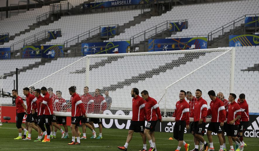 Albanian players carry a goal during a training session at the Velodrome stadium, in Marseille, France, Tuesday, June 14, 2016. Albania will face France in a Euro 2016 Group A soccer match on Wednesday. (AP Photo/Thanassis Stavrakis)