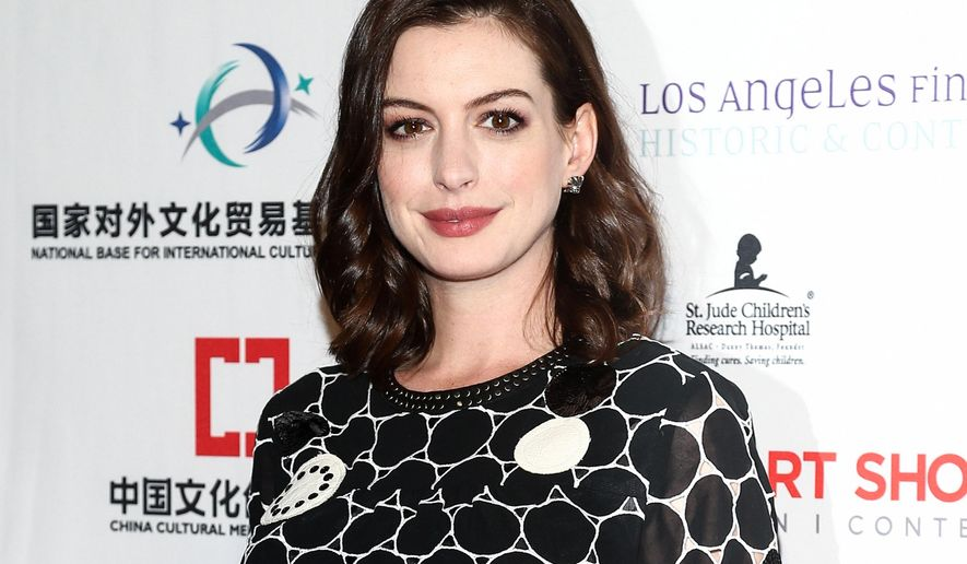 FILE - In this Jan. 27, 2016 file photo, Anne Hathaway attends the premiere party for The LA Art Show and The LA Fine Art Show in Los Angeles. The U.N. agency promoting gender equality and the empowerment of women appointed Academy Award-winning actress Anne Hathaway as a global goodwill ambassador on Wednesday, June 15, calling her a longstanding supporter of women's and girls' rights. (Photo by John Salangsang/Invision/AP, File)