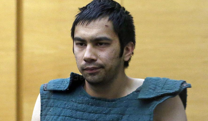 FILE- In this June 6, 2014, file photo, shooting suspect Aaron Ybarra is led to a court hearing at a King County Jail courtroom in Seattle, Wash. Dramatic video released by authorities shows Seattle Pacific University student Jon Meis pepper spraying and tackling Ybarra during the 2014 shooting that left one student dead. (AP Photo/Elaine Thompson, File)