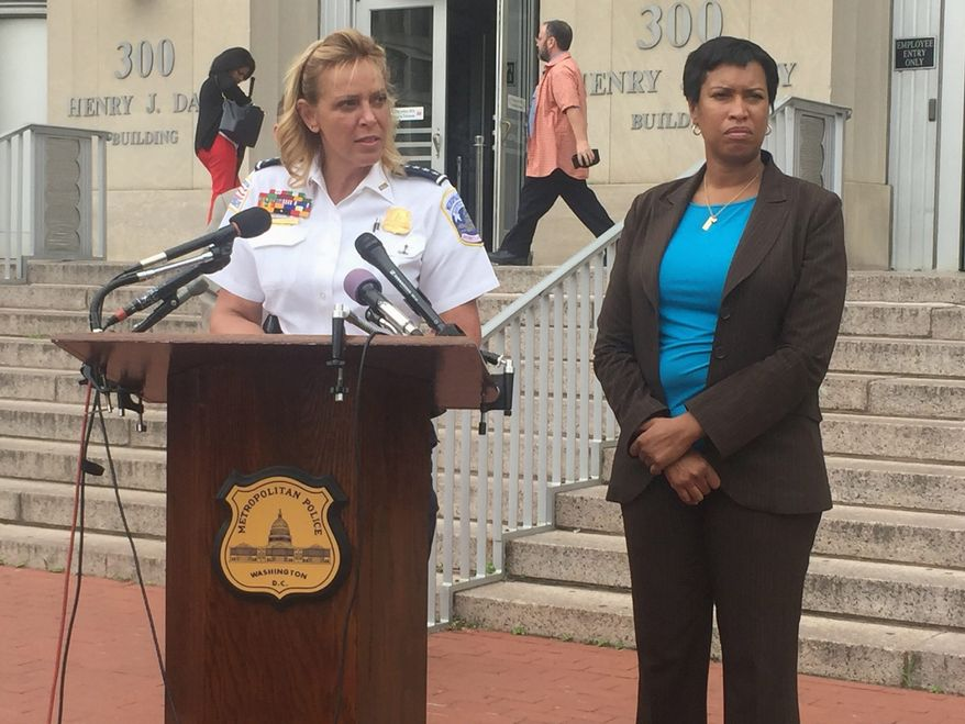 Metropolitan Police Chief Cathy L. Lanier (left), with D.C. Mayor Muriel Bowser, said surveillance cameras played a large role in identifying Kevin Cole as the driver in a recent quadruple shooting. (Emma Ann Patton / The Washington Times)