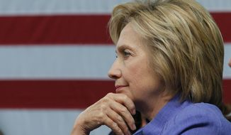 Democratic presidential candidate Hillary Clinton listens to a question during a panel discussion on national security, Wednesday, June 15, 2016, at the Virginia Air and Space Center in Hampton, Va. (AP Photo/Steve Helber) ** FILE **
