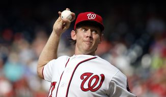 Washington Nationals starting pitcher Stephen Strasburg throws during the fourth inning of a baseball game against the Chicago Cubs at Nationals Park, Wednesday, June 15, 2016, in Washington. (AP Photo/Alex Brandon) **FILE**