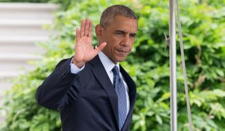 President Barack Obama waves to members of the media as he walks to Marine One on the South Lawn at the White House in Washington, Thursday, June 16, 2016, for a short trip to Andrews Air Force Base to travel to Orlando, Fla. to meet with families of the victims of the Pulse nightclub shooting. (AP Photo/Andrew Harnik)