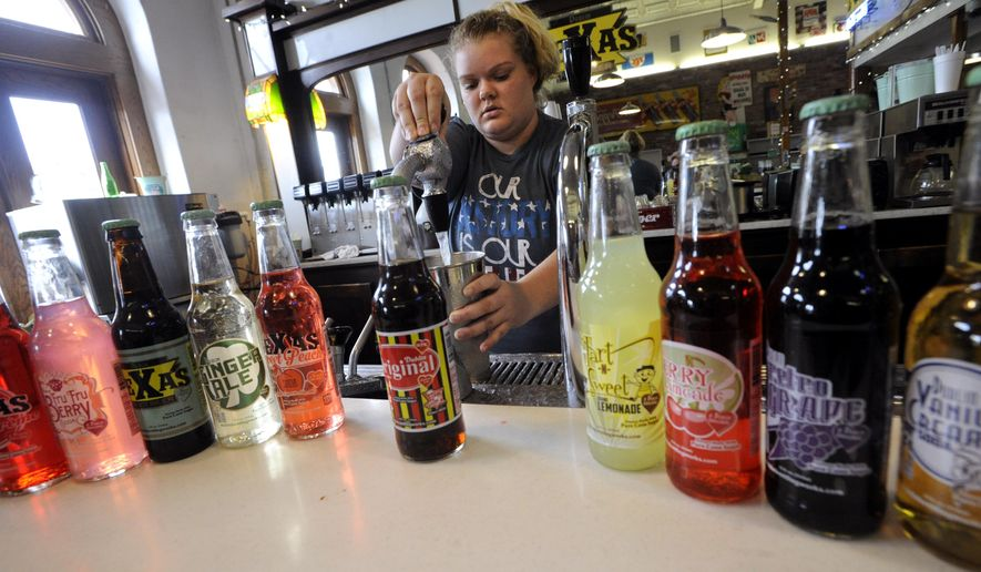 In this June 3, 2016 photo, Ryleigh Jackson makes a frosty for a customer at Old Doc's Soda Shop at the Dublin Bottling Works in Dublin, Texas. Dublin Bottling Works, the former Dublin Dr Pepper bottler, marked its 125th anniversary June 11.  (Ronald W. Erdrich/The Abilene Reporter-News via AP) MANDATORY CREDIT