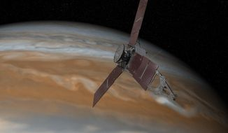 This artist's rendering made available by NASA/JPL-Caltech on July 7, 2015 shows the Juno spacecraft above Jupiter. The spacecraft is scheduled to arrive at the planet on July 4, 2016 to begin a nearly year-long study of the gas giant. (NASA/JPL-Caltech via AP)
