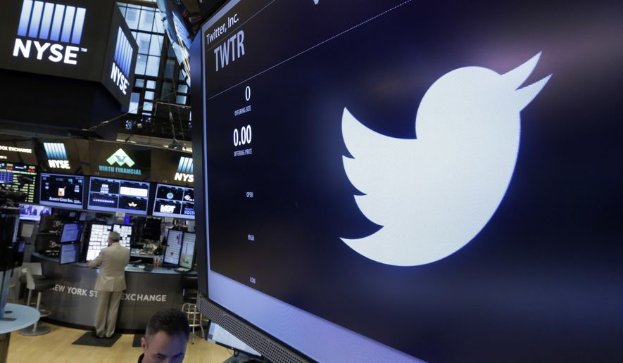 The Twitter logo appears at the post where it trades, on the floor of the New York Stock Exchange, Friday, June 17, 2016. (AP Photo/Richard Drew) ** FILE **