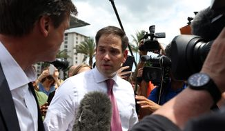 Florida Sen. Marco Rubio answers questions from the press after paying his respects to the victims of the Pulse nightclub shooting at Dr. Phillips Center for the Performing Arts in Orlando, Fla., on Thursday, June 16, 2016. (Joshua Lim/Orlando Sentinel via AP) ** FILE **