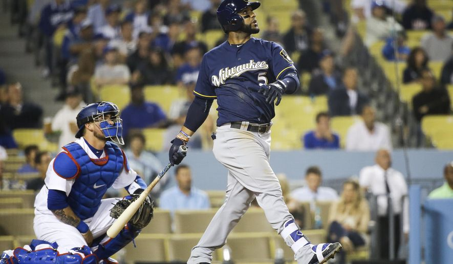 Milwaukee Brewers' Jonathan Villar watches the flight of his two-run home run during the ninth inning of a baseball game against the Los Angeles Dodgers, Thursday, June 16, 2016, in Los Angeles. (AP Photo/Jae C. Hong)