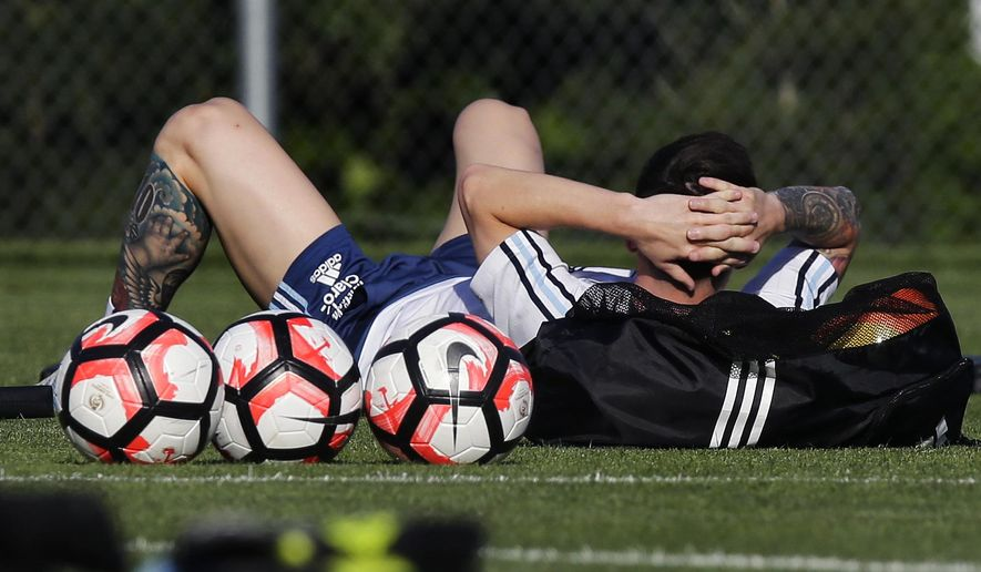 Argentina's Lionel Messi lays on the field before soccer practice at Gillette Stadium, Friday, June 17, 2016, in Foxborough, Mass. Argentina will face Venezuela in the quarterfinal round of the Copa America Centenario tournament on Saturday. (AP Photo/Charles Krupa)