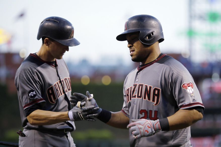 Arizona Diamondbacks' Yasmany Tomas, right, and Nick Ahmed celebrate after Tomas' home run off Philadelphia Phillies starting pitcher Adam Morgan during the fourth inning of a baseball game, Friday, June 17, 2016, in Philadelphia. (AP Photo/Matt Slocum)