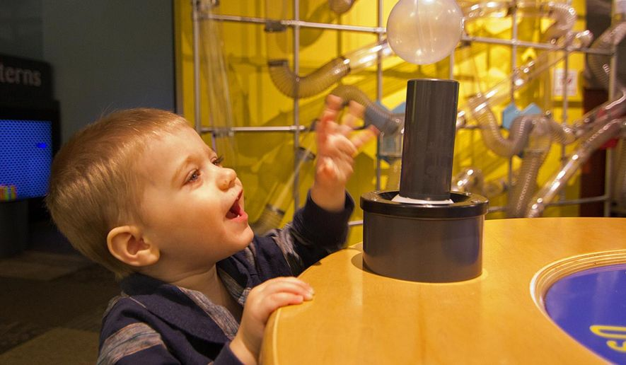 ADVANCE FOR USE SUNDAY, JUNE 19, 2016 AND THEREAFTER - In this Feb. 2, 2016 photo, Noah King, 1, of Knoxville plays with a floating ball during Toddler Tuesday at the Discovery Depot Children's Museum in Galesburg. The Discovery Depot children's museum didn't happen until Anne Golden first dreamed it 20 years ago. vThe museum had about 2,000 to 3,000 visitors a year in its first few years, Golden says, and it now sees about 42,000 visitors a year. (Lewis Marien/The Register-Mail via AP)