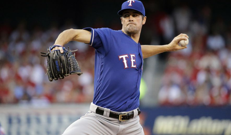 Texas Rangers starting pitcher Cole Hamels throws during the first inning of a baseball game against the St. Louis Cardinals, Friday, June 17, 2016, in St. Louis. (AP Photo/Jeff Roberson)
