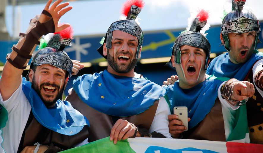 Italy supporters dressed as Roman soldiers cheer on the stands prior to the Euro 2016 Group E soccer match between Italy and Sweden at the Stadium municipal in Toulouse, France, Friday, June 17, 2016. (AP Photo/Andrew Medichini)