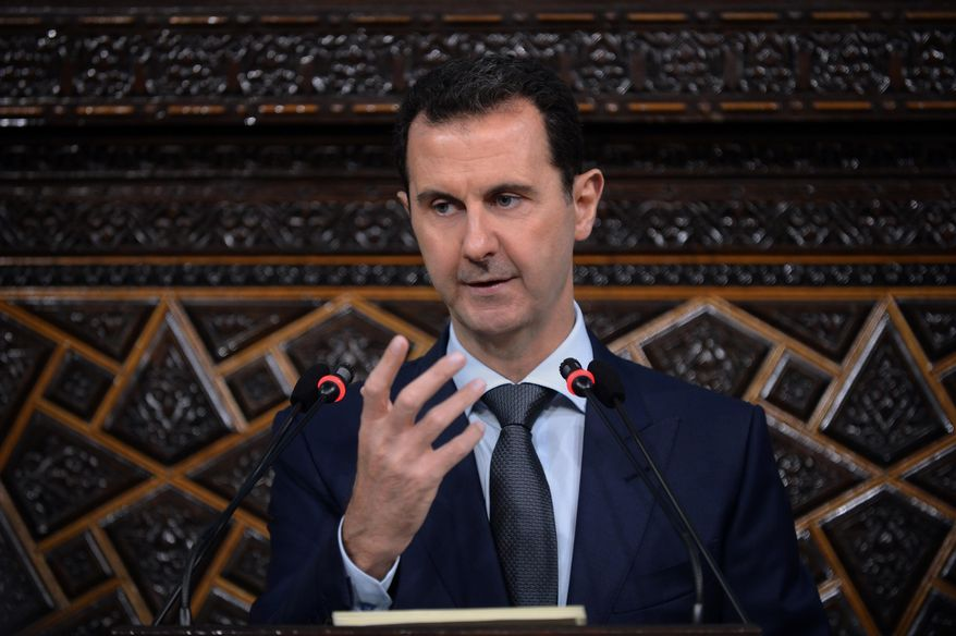 In this photo released by the Syrian official news agency SANA, Syrian President Bashar Assad speaks in Damascus, Syria, Tuesday, June 7, 2016. State Department officials shook up America's generally obedient diplomatic establishment this week with an internal memo urging U.S. military action against Syria's government with the goal of pressing Assad to accept a cease-fire and gaining the upper hand on him in future talks on a political transition. (SANA via AP)