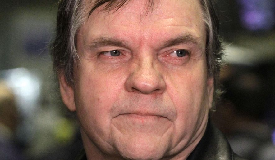 This June 21, 2010, file photo shows rock singer Meatloaf on the floor of the New York Stock Exchange before ringing the opening bell.  Rock singer Meat Loaf collapsed on stage during a concert. (AP Photo/Richard Drew, File)