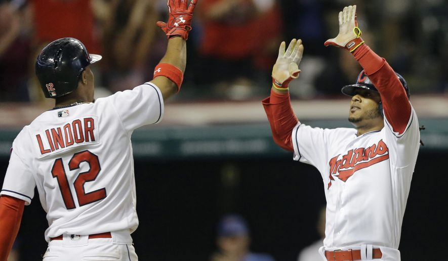 Cleveland Indians' Michael Martinez, right, and Francisco Lindor celebrate after Martinez scored on Jason Kipnis's double during the eighth inning of a baseball game against the Chicago White Sox, Friday, June 17, 2016, in Cleveland. (AP Photo/Tony Dejak)