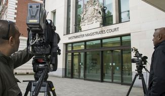 Members of the media set up outside Westminster Magistrates Court, London, Saturday June 18, 2016, where Thomas Mair was due to appear charged with the murder of British Member of Parliament Jo Cox. Labour Party lawmaker Cox, 41, was shot and stabbed to death Thursday after getting out of her car in the town of Birstall in her home constituency. (Anthony Devlin/PA via AP) UNITED KINGDOM OUT NO SALES NO ARCHIVE