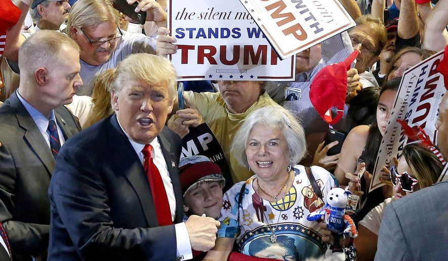 Republican presidential candidate Donald Trump, left, shouts to Secret Service agents that supporter Diana Brest, right, had been waiting in line since 2 a.m. to see the candidate speak at a rally Saturday, June 18, 2016, in Phoenix. (AP Photo/Ross D. Franklin) ** FILE **