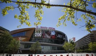 In this June 17, 2016 photo, an advertisement plays on a screen at the T-Mobile Arena in Las Vegas. A National Hockey League plan to expand to Las Vegas is being cheered by fans and backers of a years-long effort to get a pro sports franchise in Sin City, but hockey will have to elbow into a crowded entertainment lineup featuring casino games, celebrity shows, Cirque du Soleil productions and pulsing nightclubs  not to mention boxing matches, UFC fights and events like the National Finals Rodeo. (AP Photo/John Locher)