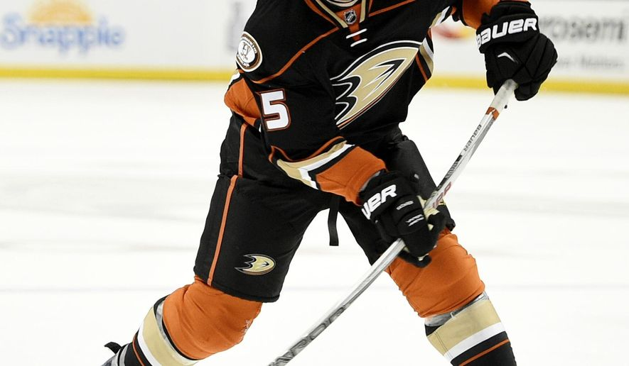 FILE - This April 5, 2016 file photo shows Anaheim Ducks defenseman Sami Vatanen, of Finland, attempting a shot during the second period of an NHL hockey game against the Winnipeg Jets in Anaheim, Calif. Vatanen re-signed with the Anaheim Ducks on Saturday, July 18, 2016 agreeing to a four-year, $19.5 million deal through the 2019-20 season. (AP Photo/Kelvin Kuo)