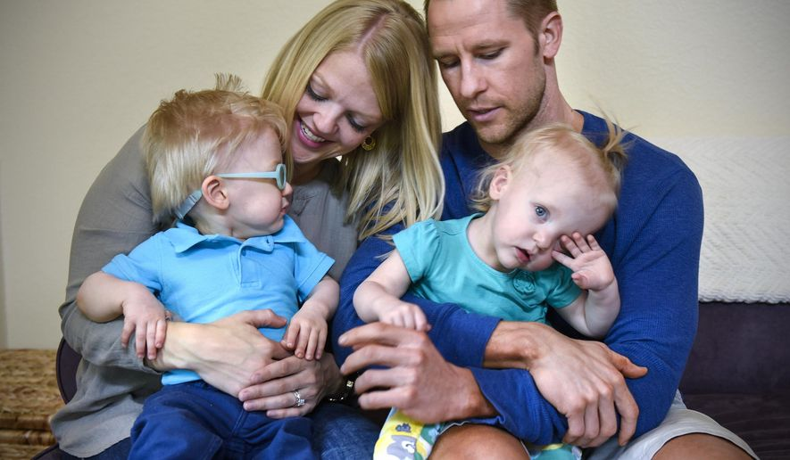 ADVANCE FOR WEEKEND EDITIONS - In this Wednesday, June 1, 2016 photo, Alyssa and Scott Gullickson hold their twins Evan and Brielle at their home near St. Joseph, Minn. Evan and Brielle were born 17 days apart. (Dave Schwarz/St. Cloud Times via AP) MANDATORY CREDIT