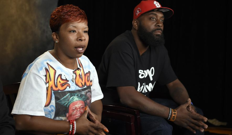 FILE - In this Sept. 27, 2014 file photo, the parents of Michael Brown, Lesley McSpadden, left, and Michael Brown, Sr., right, sit for an interview with The Associated Press in Washington. Attorneys representing Ferguson, Mo., its former police chief and an ex-officer in a wrongful-death lawsuit by Brown's parents are pressing the latest quest for access to any of the late 18-year-old's juvenile records. Anthony Gray, a Brown family attorney, has said any brush by Brown with the juvenile court system is irrelevant to whether Brown's 2014 death resulted from excessive police force.(AP Photo/Susan Walsh, File)