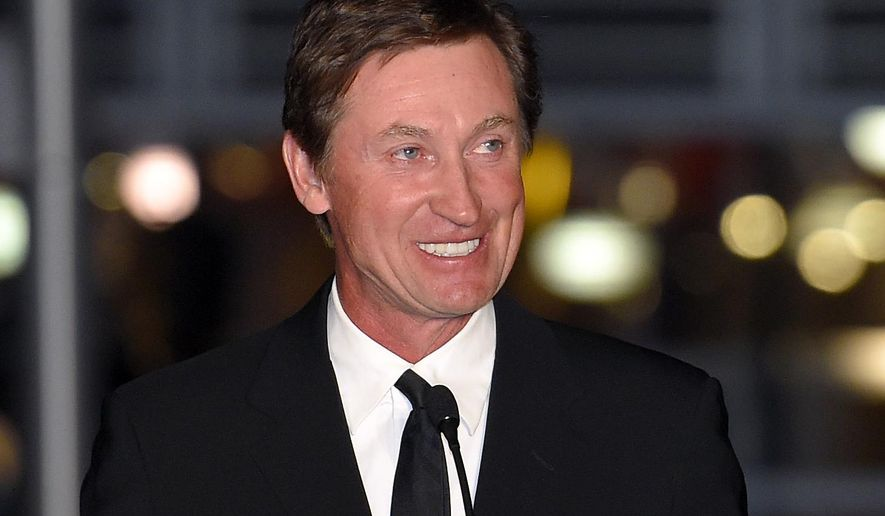 FILE - In this March 7, 2015 file photo, former Kings player Wayne Gretzky speaks to the crowd at a statue unveiling for former Kings left wing Luc Robitaille prior to an NHL hockey game against the Pittsburgh Penguins in Los Angeles. Having played a significant role in popularizing hockey in America's southwest, Gretzky is turning his attention to a new frontier. The Great One's heading Down Under as part five-game exhibition series to promote the game in Australia.  (AP Photo/Mark J. Terrill, File)
