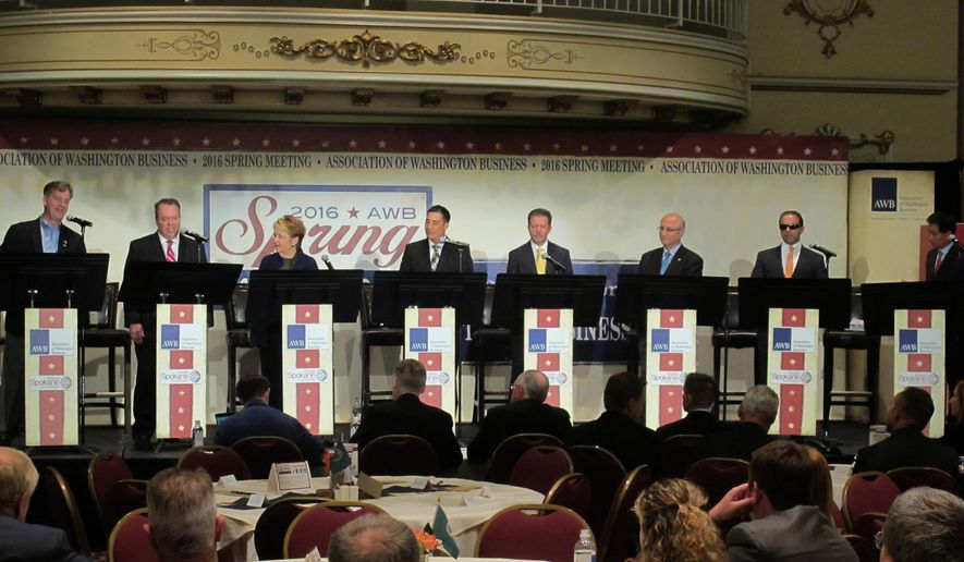 In this photo taken June 14, 2016, eight of the 11 candidates for Washington lieutenant governor take part in a debate in Spokane, Wash. From left, Marty McClendon, Paul Addis, Sen. Karen Fraser, D-Olympia, Sen. Steve Hobbs, D-Lake Stevens, Bill Penor, Javier Figueroa, Sen. Cyrus Habib, D-Bellevue, and Phillip Yin, all stand at their podiums. The top two vote-getters in the Aug. 2, 2016 primary will advance to the Nov. 8, 2016, general election. (AP Photo/Nicholas K. Geranios)