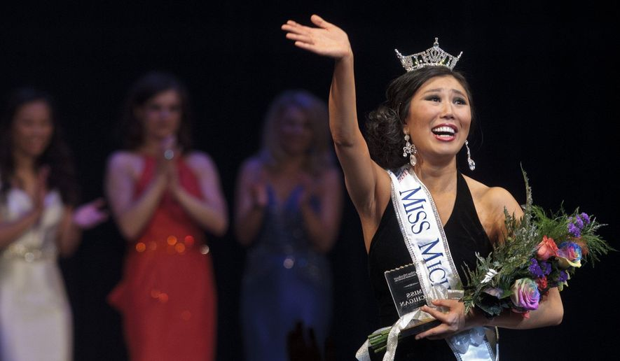 Miss Wayne County Arianna Quan reacts as she is crowned Miss Michigan 2016 during the final night of the Miss Michigan Scholarship Pageant at the Frauenthal Center for the Performing Arts on Saturday, June 18, 2016, in Muskegon, Mich. (Joel Bissell/Muskegon Chronicle-MLive.com via AP) MANDATORY CREDIT