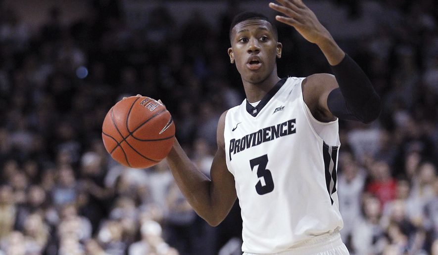 This Feb. 13, 2016 photo shows Providence guard Kris Dunn (3) during the first half of an NCAA college basketball game against Georgetown in Providence, R.I. Dunn is expected to be one of the top upperclassmen selected in the NBA draft on Thursday, June 23, 2016. (AP Photo/Stew Milne)