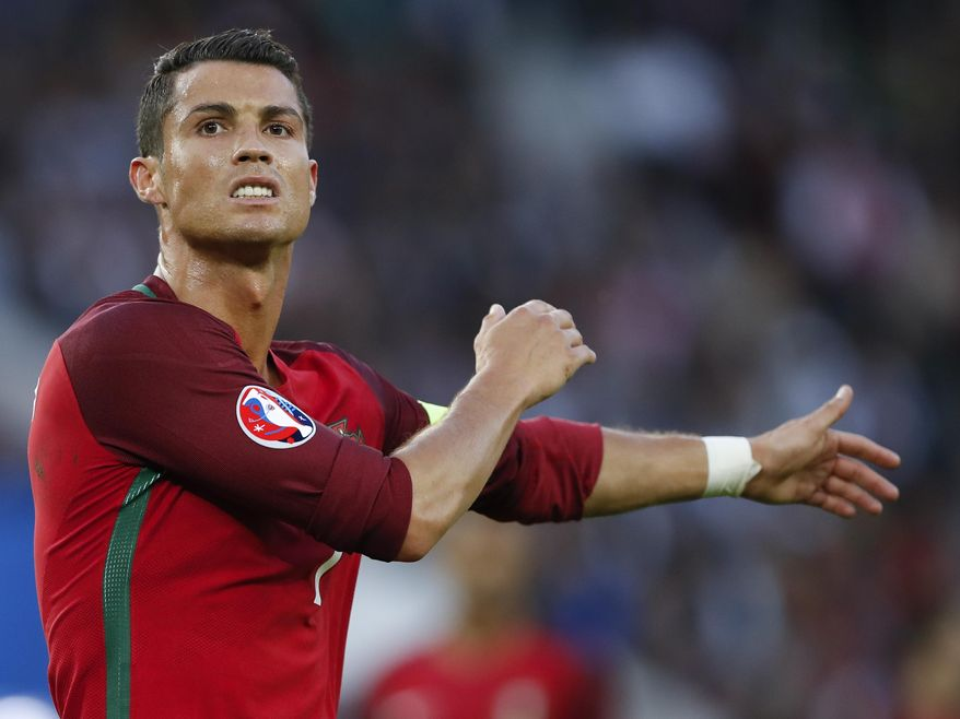 Portugal's Cristiano Ronaldo stands on the pitch during the Euro 2016 Group F soccer match between Portugal and Austria at the Parc des Princes stadium in Paris, France, Saturday, June 18, 2016. (AP Photo/Christophe Ena)