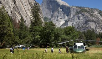 The Obamas toured Yosemite, the country's oldest national park, to mark the 100th anniversary of the park system. President Obama, who said rising temperatures are damaging national parks, has proposed a 9 percent increase to boost the National Park Service's annual funding to $3.1 billion. (Associated Press)